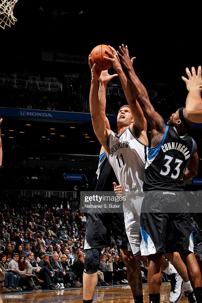 Brook Lopez #11 of the Brooklyn Nets shoots against Dante Cunningham #33 of the Minnesota Timberwolves on November 5, 2012 at the Barclays Center in Brooklyn, New York.