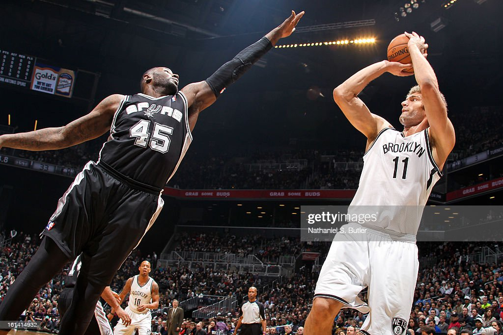 Brook Lopez #11 of the Brooklyn Nets shoots against DeJuan Blair #45 of the San Antonio Spurs on February 10, 2013 at the Barclays Center in the Brooklyn borough of New York City.