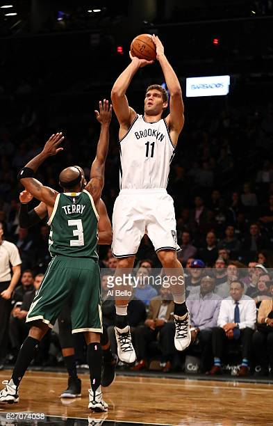 Brook Lopez of the Brooklyn Nets shoots against Jason Terry of the Milwaukee Bucks during their game at Barclays Center on December 1 2016 in New...