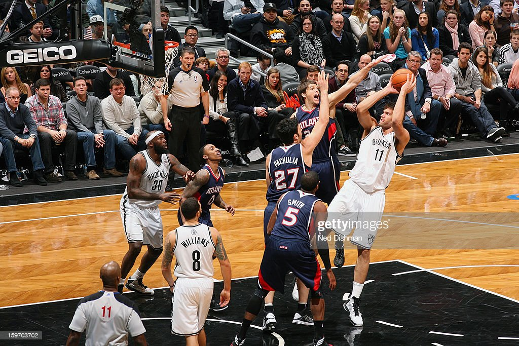 Brook Lopez #11 of the Brooklyn Nets shoots over the Atlanta Hawks at the Barclays Center on January 18, 2013 in the Brooklyn borough of New York City in New York City.