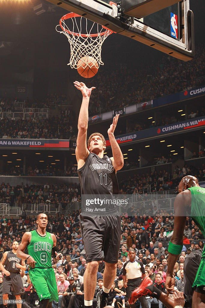 Brook Lopez #11 of the Brooklyn Nets shoots the ball against the Boston Celtics on December 25, 2012 at the Barclays Center in Brooklyn, New York.