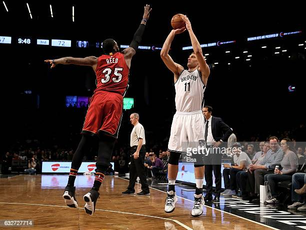Brook Lopez of the Brooklyn Nets takes a shot as Willie Reed of the Miami Heat defends at the Barclays Center on January 25 2017 in the Brooklyn...