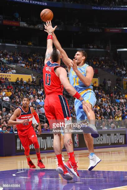 Brook Lopez of the Los Angeles Lakers and Marcin Gortat of the Washington Wizards vie for the ball during the game on October 25 2017 at STAPLES...
