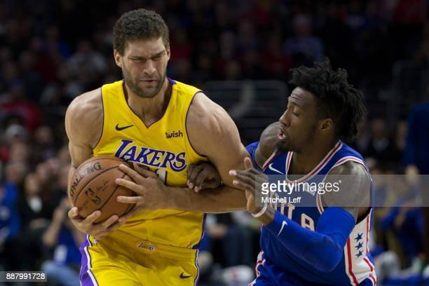 Brook Lopez of the Los Angeles Lakers drives to the basket against Robert Covington of the Philadelphia 76ers in the second quarter at the Wells...