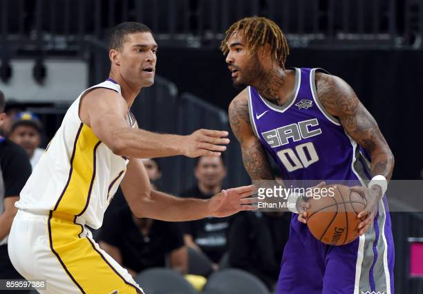 Brook Lopez of the Los Angeles Lakers guards Willie CauleyStein of the Sacramento Kings during their preseason game at TMobile Arena on October 8...