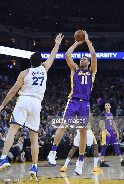 Brook Lopez of the Los Angeles Lakers shoots over Zaza Pachulia of the Golden State Warriors during an NBA basketball game at ORACLE Arena on March...