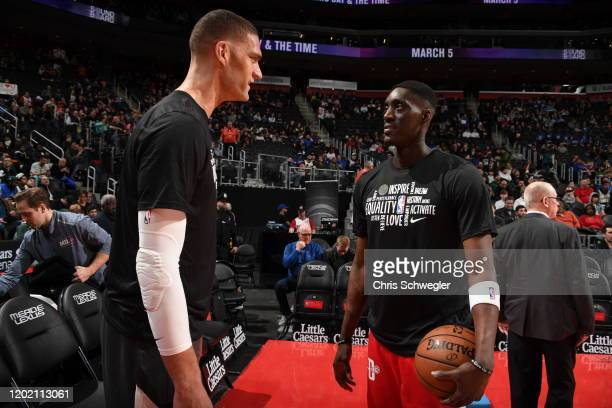 Brook Lopez of the Milwaukee Bucks and Tony Snell of the Detroit Pistons talk prior to a game on February 20 2020 at Little Caesars Arena in Detroit...