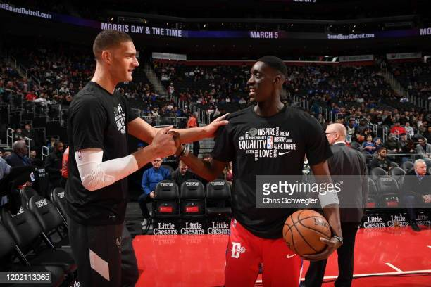 Brook Lopez of the Milwaukee Bucks and Tony Snell of the Detroit Pistons hifive prior to a game on February 20 2020 at Little Caesars Arena in...