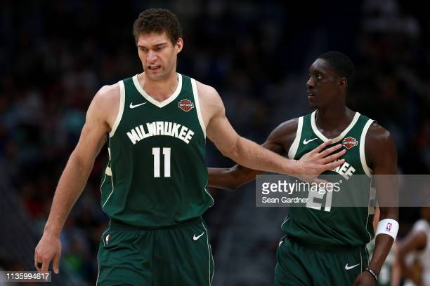 Brook Lopez of the Milwaukee Bucks and Tony Snell of the Milwaukee Bucks stands on the court during the second half of a NBA game against the New...