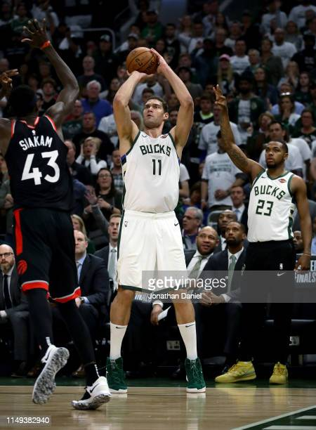 Brook Lopez of the Milwaukee Bucks attempts a shot while being guarded by Pascal Siakam of the Toronto Raptors in the third quarter in Game One of...