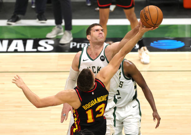 Brook Lopez of the Milwaukee Bucks blocks a during the second half in Game Five of the Eastern Conference Finals at Fiserv Forum on July 01, 2021 in...
