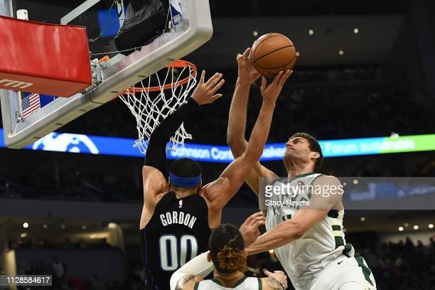 Brook Lopez of the Milwaukee Bucks blocks a shot by Aaron Gordon of the Orlando Magic during the second half of a game at Fiserv Forum on February 09...