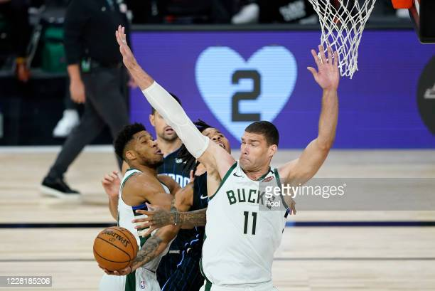 Brook Lopez of the Milwaukee Bucks blocks a shot by Markelle Fultz of the Orlando Magic in the first half of Game Four during the first round of the...