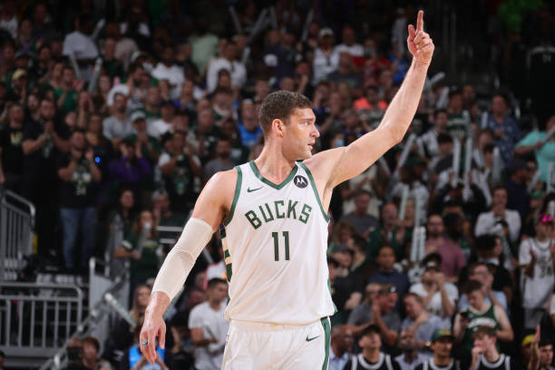 Brook Lopez of the Milwaukee Bucks celebrates during Game 5 of the Eastern Conference Finals of the 2021 NBA Playoffs on July 1, 2021 at the Fiserv...