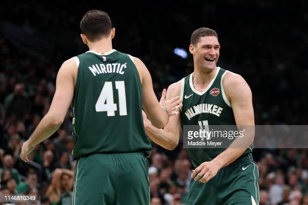 Brook Lopez of the Milwaukee Bucks celebrates with Nikola Mirotic of the Milwaukee Bucks during the second half of Game 3 of the Eastern Conference...