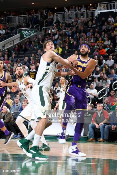 Brook Lopez of the Milwaukee Bucks defends JaVale McGee of the Los Angeles Lakers on March 19 2019 at the Fiserv Forum Center in Milwaukee Wisconsin...