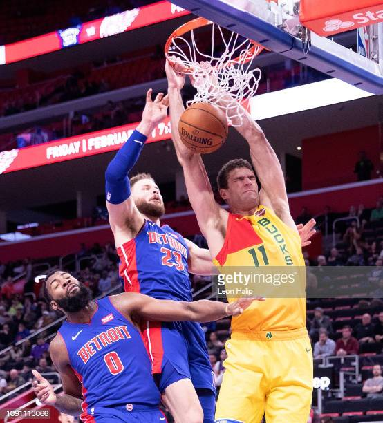 Brook Lopez of the Milwaukee Bucks dunks against Andre Drummond and Blake Griffin of the Detroit Pistons defend during the third quarter of the game...