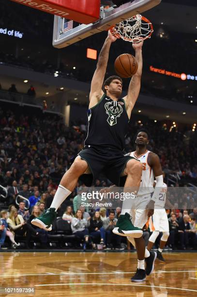 Brook Lopez of the Milwaukee Bucks dunks against the Phoenix Suns during the first half of a game at Fiserv Forum on November 23 2018 in Milwaukee...