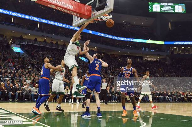 Brook Lopez of the Milwaukee Bucks dunks over Luke Kornet of the New York Knicks during the first half of a game at Fiserv Forum on December 27 2018...