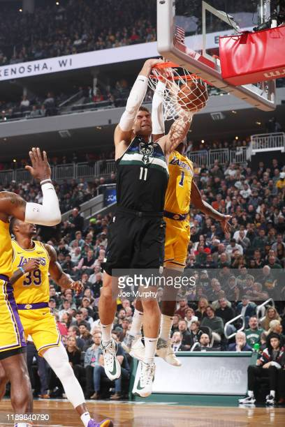 Brook Lopez of the Milwaukee Bucks dunks the ball against the Los Angeles Lakers on December 19 2019 at the Fiserv Forum Center in Milwaukee...