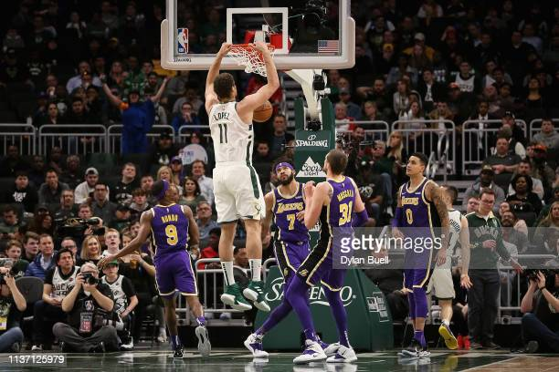 Brook Lopez of the Milwaukee Bucks dunks the ball in the third quarter against the Los Angeles Lakers at the Fiserv Forum on March 19 2019 in...