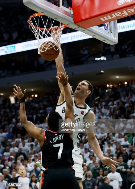 Brook Lopez of the Milwaukee Bucks dunks the ball over Kyle Lowry of the Toronto Raptors in the fourth quarter in Game One of the Eastern Conference...