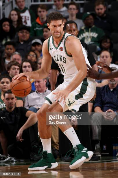 Brook Lopez of the Milwaukee Bucks handles the ball against the Minnesota Timberwolves during a preseason game on October 12 2018 at Fiserv Forum in...