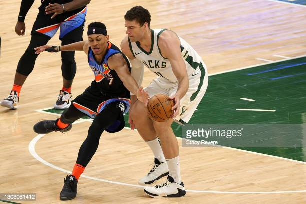 Brook Lopez of the Milwaukee Bucks is defended by Darius Bazley of the Oklahoma City Thunder during the first half of a game at Fiserv Forum on...