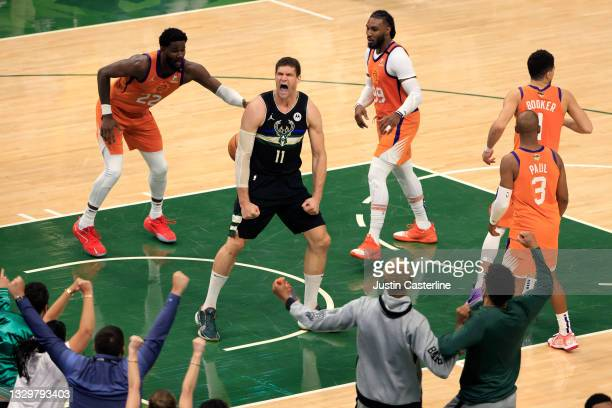 Brook Lopez of the Milwaukee Bucks reacts to a dunk against the Phoenix Suns during the second half in Game Six of the NBA Finals at Fiserv Forum on...