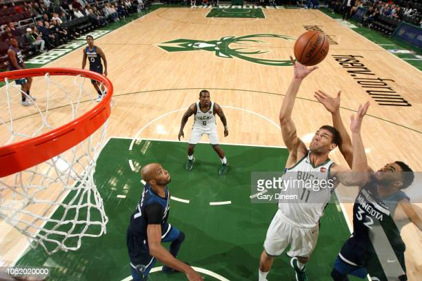 Brook Lopez of the Milwaukee Bucks shoots the ball against the Minnesota Timberwolves during a preseason game on October 12 2018 at Fiserv Forum in...