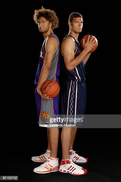 Brook Lopez of the New Jersey Nets and Robin Lopez of the Phoenix Suns pose for a portrait during the 2008 NBA Rookie Photo Shoot on July 29 2008 at...