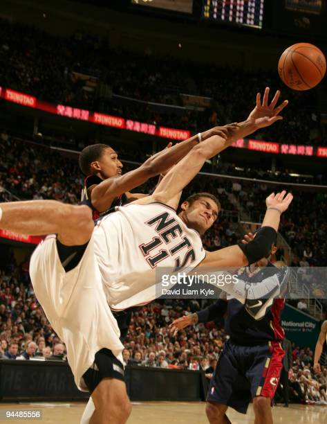 Brook Lopez of the New Jersey Nets battles for the loose ball with Jamario Moon of the Cleveland Cavaliers on December 15 2009 at The Quicken Loans...