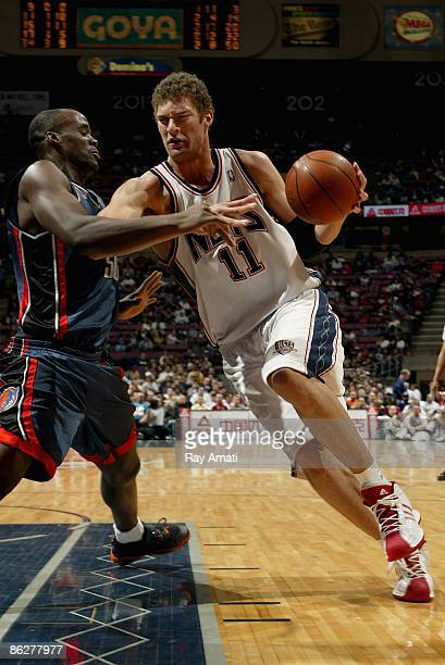 Brook Lopez of the New Jersey Nets drives against Emeka Okafor of the Charlotte Bobcats during the game on April 13 2009 at the Izod Center in East...