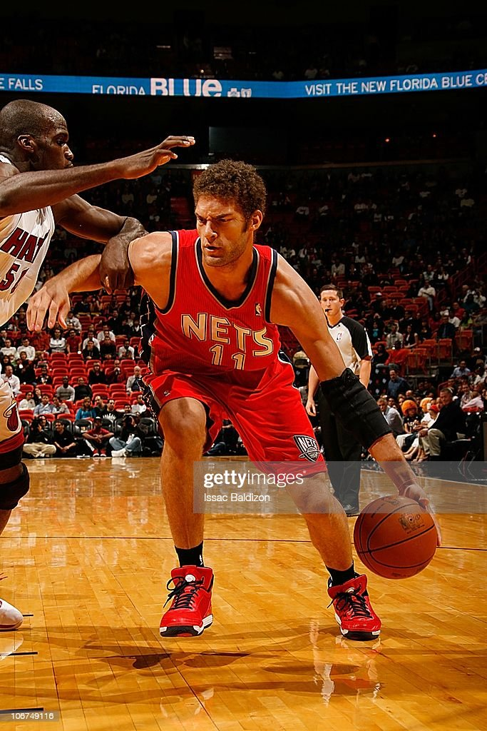 best authentic 4c311 b1609 Brook Lopez of the New Jersey Nets drives low during the ...