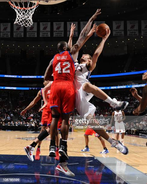 Brook Lopez of the New Jersey Nets shoots against Elton Brand of the Philadelphia 76ers during the game on February 2 2011 at the Prudential Center...