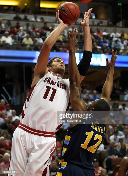 Brook Lopez of the Stanford Cardinal shoots over the defense of Dwight Burke of the Marquette Golden Eagles during the South Region second round of...