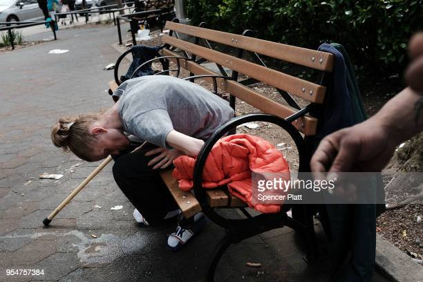 Brooke a homeless heroin addict passes out in a park where heroin users gather to shoot up in the Bronx on May 4 2018 in New York City In an attempt...