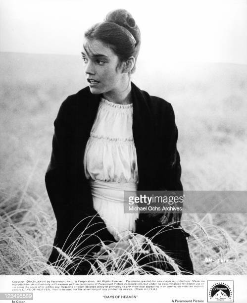 Brooke Adams enjoys time in the tall grass in a scene from the film 'Days Of Heaven' 1978