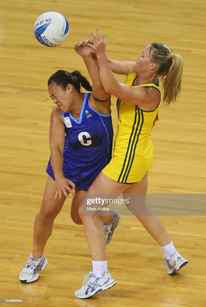 Brooke Amber Williams of Samoa and Kimberlee Green of Australia compete for the ball during the preliminary round group A netball match between Australia and Samoa at the Thyagaraj Sports Complex during day one of the Delhi 2010 Commonwealth Games on October 4, 2010 in Delhi, India.
