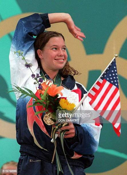 Brooke Bennett of the US waves after receiving her Olympic gold medal she won in the 800m fresstyle at the Georgia Tech Aquatic Center 25 July...