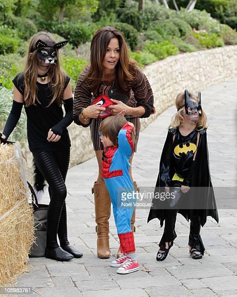 Brooke Burke and her children Sierra Sky Fisher Shaya Braven Charvet and Heaven Rain Charvet attend the Pottery Barn Kids' Halloween Carnival...