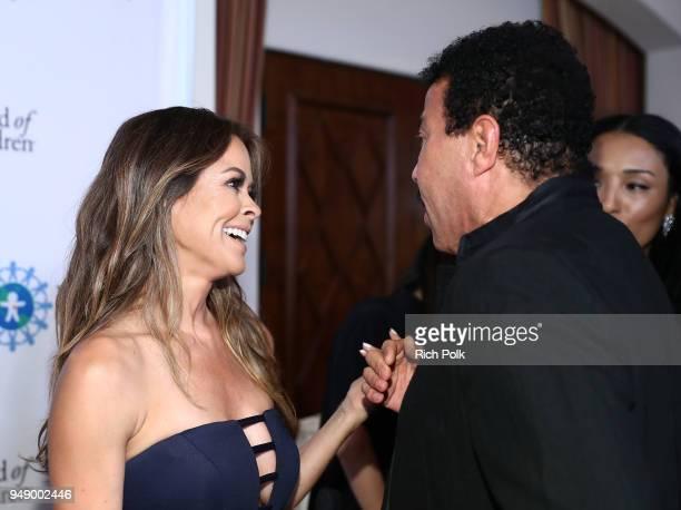 Brooke Burke and Lionel Richie attend the 2018 World of Children Hero Awards Benefit at Montage Beverly Hills on April 19 2018 in Beverly Hills...