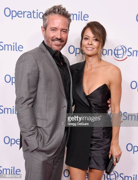 Brooke Burke and Scott Rigsby arrive at Operation Smile's Hollywood Fight Night at The Beverly Hilton Hotel on November 6, 2019 in Beverly Hills,...