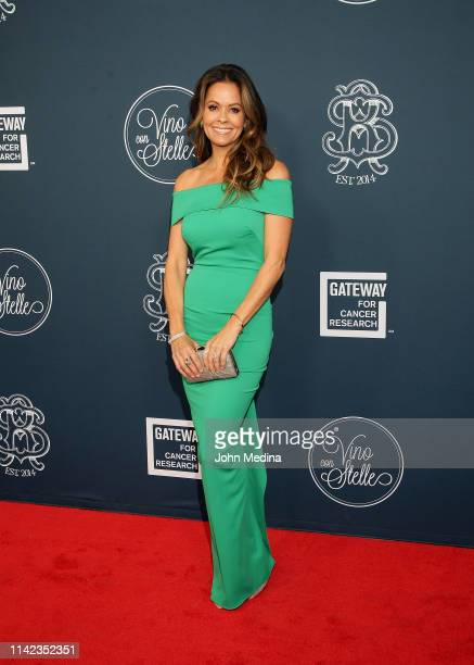 Brooke Burke poses for photos on the red carpet before the 3rd annual Vino con Stelle Gateway for Cancer Research event at Gemini Hangar on April 12...