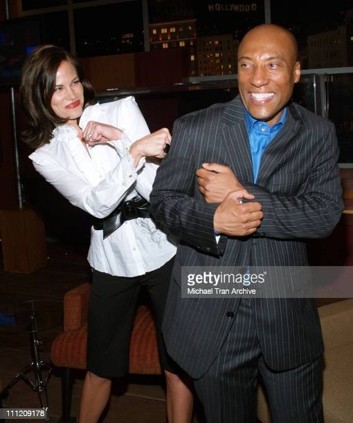 Brooke Burns and Byron Allen during Comics Unleashed Television Premiere Party at Sunset Gower Studios Stage 9 in Hollywood California United States