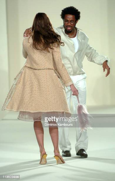 Brooke Burns and Dhanie Jones wearing fashions presented by Saks Fifth Avenue at the Gridiron Glamour fashion show