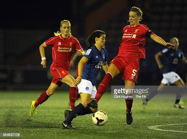 Brooke Chaplen of Everton Ladies FC is tackled by Genna Bonner of Liverpool Ladies FC during the FA WSL 1 match between Everton Ladies FC and...