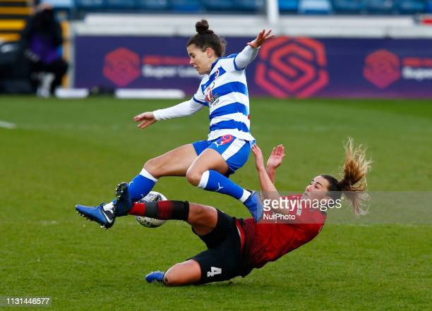 Brooke Chaplen of Reading FC Women gets tackle by Amy Turner of Manchester United Women during The SSE Womens FA Cup Quarter Final match between...