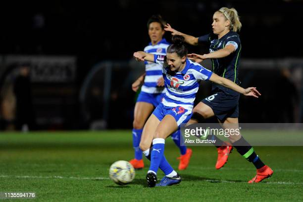 Brooke Chaplen of Reading scores her team's first goal under pressure from Steph Houghton of Manchester City during the FA Women's Super League match...