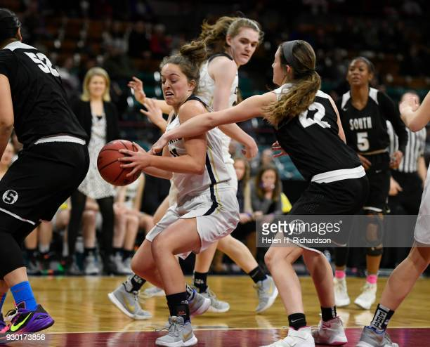 Brooke Crowell #22 Pueblo South reaches in for the ball against Baylee GalanBrowne #11 left Evergreen in the first half of the 4A state championship...